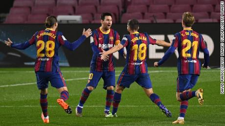 Jordi Alba celebrates with Messi after scoring Barcelona's opening goal.
