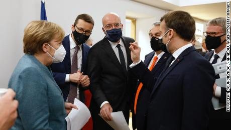 German Chancellor Angela Merkel, European Council President Charles Michel (center) and Macron at the EU Leaders Summit in Brussels on Friday, December 11.
