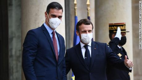 Macron at the Elysee on Tuesday with Spanish Prime Minister Pedro Sanchez, who is also quarantining as a precaution.
