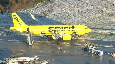 A Spirit Airlines plane's front wheel slid into the grass when it slid off the taxiway at BWI Airport.