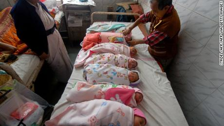 An Indian health official administers polio vaccination drops to newborn babies at a hospital in Agartala, India's northeastern state of Tripura.