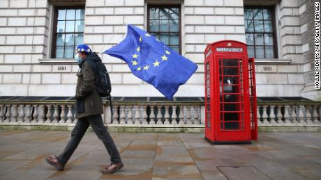 A man wearing an EU flag-themed beret and carrying an EU flag is seen on Whitehall in central London on December 11, 2020.