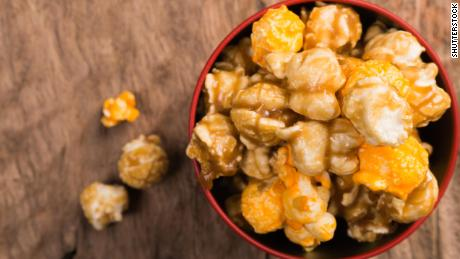 Christmas movie watching is incomplete without hot caramel popcorn for snacking.