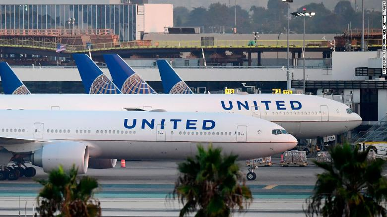United passenger who died may have had Covid-19 symptoms, airline says