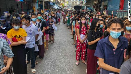 People stand in lines to get Covid-19 tests in Samut Sakhon, Thailand, on Sunday, December 20, 2020.