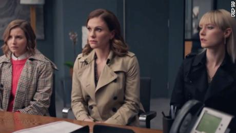 "Anna Paquin (center) stars as PR executive Robyn in ""Flack."""