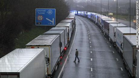 Trucks parked on the M20 near Folkestone, Kent, as part of Operation Stack after the Port of Dover was closed and access to the Eurotunnel terminal suspended.