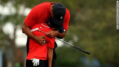 Tiger Woods hugs his son Charlie  on the 18th hole after the final round of the PNC Championship.