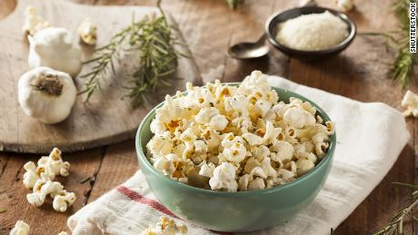 To accompany holiday movie watching, a bowl of hot popcorn with freshly grated Parmesan is just the ticket.