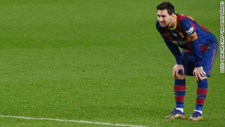 Messi looks on during Barcelona's draw with Valencia on Saturday.