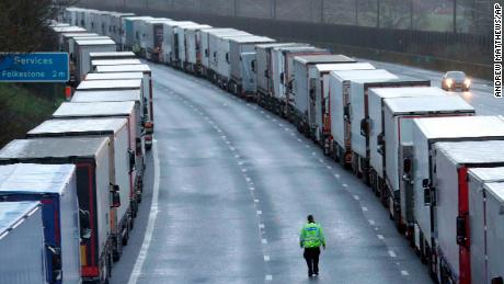 Police patrol along the M20 motorway where freight traffic is parked whilst the port of Dover remains closed on Tuesday.