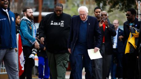 Killer Mike walks with Sen. Bernie Sanders before a campaign event in February, ahead of the presidential primary.