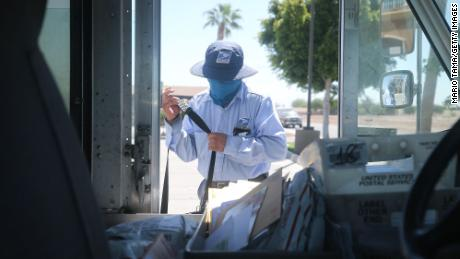 A postal worker wears a face mask during the Covid-19 pandemic.