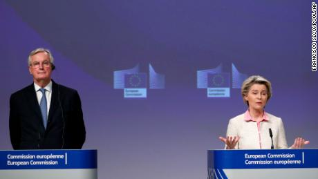 Ursula von der Leyen and Michel Barnier address a media conference on Brexit at EU headquarters in Brussels, Thursday, Dec. 24, 2020.