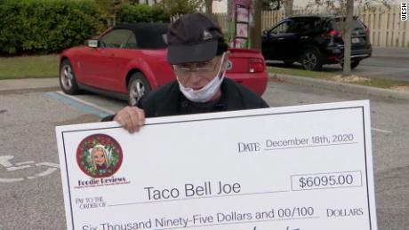 Joe DeCicco holding the check.