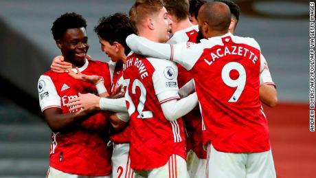 Arsenal's Bukayo Saka (far left) celebrates with his teammates after scoring his side's third goal at the Emirates Stadium against Chelsea.
