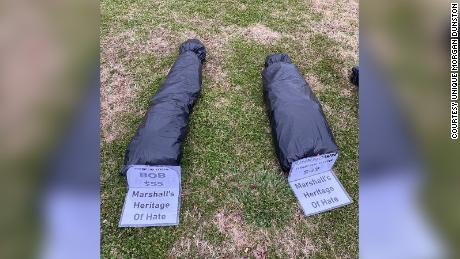 The body bags on the Marshall County Courthouse lawn.