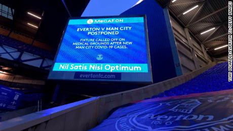 A big screen graphic announcing the fixture being called off before the expected Premier League match between Everton and Manchester City at Goodison Park on December 28 2020 in Liverpool, England.