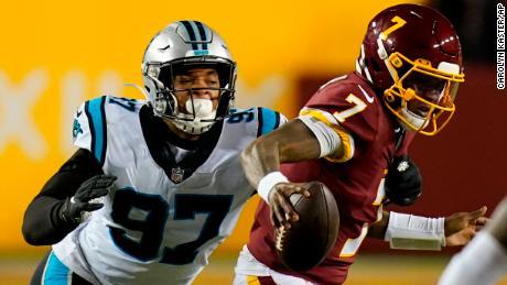 Washington Football Team quarterback Dwayne Haskins (7) runs away from Carolina Panthers defensive end Yetur Gross-Matos (97) on Sunday.