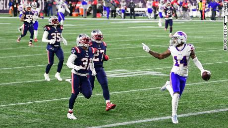 Diggs taunts New England Patriots defenders as he runs into the end zone for a touchdown.