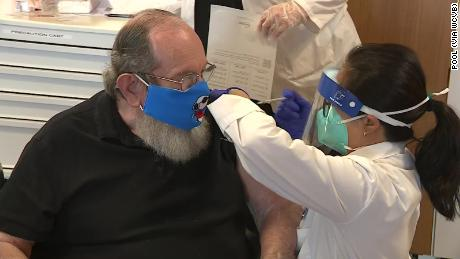 Veterans nursing home where at least 76 died of Covid-19 administers its first vaccines