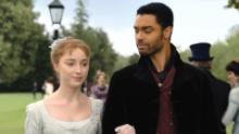 "Phoebe Dynevor as Daphne Bridgerton and Regé-Jean Page as Simon, the Duke of Hastings in ""Bridgerton."""