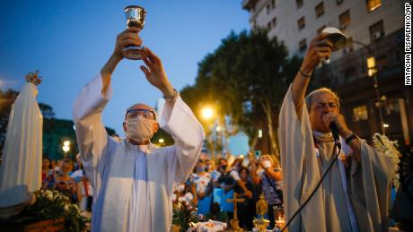 Catholic priests hold a mass during an anti-abortion protest as lawmakers debated its legalization, outside Congress in Buenos Aires on Tuesday.