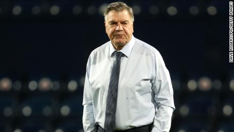 Allardyce watches warm up prior to a Premier League match.