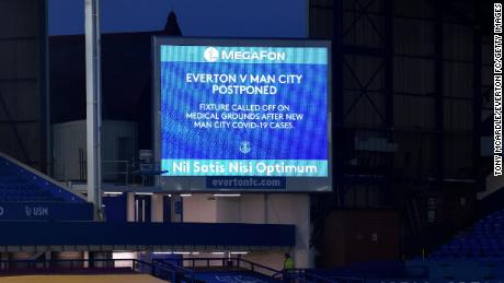 A big screen graphic announcing the fixture being called off before the Premier League match between Everton and Manchester City.