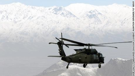 A UH-60 with 1st Armored Division Combat Aviation Brigade transports troops across the Combined Joint Operations Area of Afghanistan.