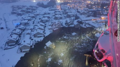 A rescue helicopter view shows the aftermath of the incident.
