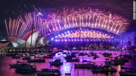 Fireworks explode over the Sydney Opera House and Harbour Bridge to ring in 2021. One million people would usually crowd the Sydney Harbor to watch the annual fireworks that center on the Sydney Harbour Bridge. But this year authorities advised revelers to watch the fireworks on television.