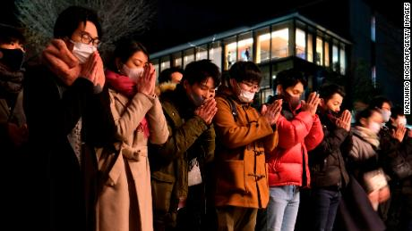 People visit Kanda Myojin Shrine to offer New Year prayers in Tokyo on the first day of 2021.