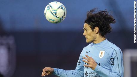 Cavani of Uruguay heads the ball during the warmup before a South American World Cup qualifier against Brazil  on November 17, 2020 in Montevideo, Uruguay.