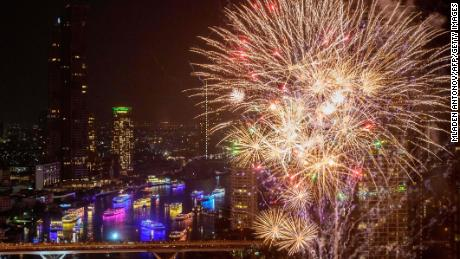 New Year's Eve fireworks erupt over the Chao Phraya river during the fireworks show in Bangkok on January 1, 2021.