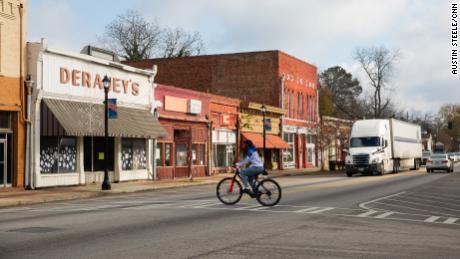 A man rides a bike through downtown Sparta last month.