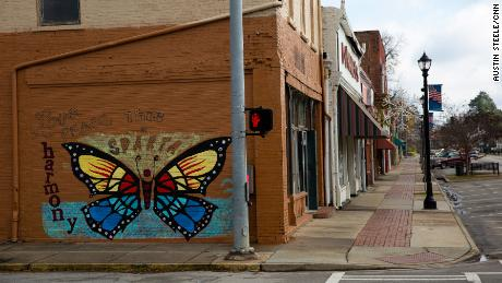 """A mural declares, """"This is Sparta,"""" on a building downtown, where many storefronts sit empty."""