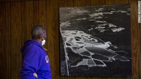 Thornton examines an old aerial photograph of his property, when it was a functioning catfish farm in Hancock County.