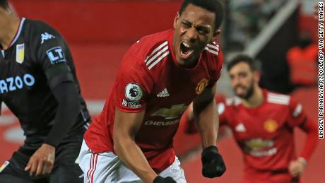 Manchester United's Anthony Martial celebrates after scoring the opening goal against Aston Villa on Friday, January 1.