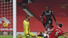 Aston Villa striker Bertrand Traore shoots past David de Gea to draw his team level in the 58th minute at Old Trafford on Friday, January 1.