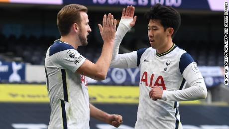 Harry Kane celebrates with Son Heung-min after putting Tottenham Hotspur ahead against Leeds United. Son later scored the second in a 3-0 win.