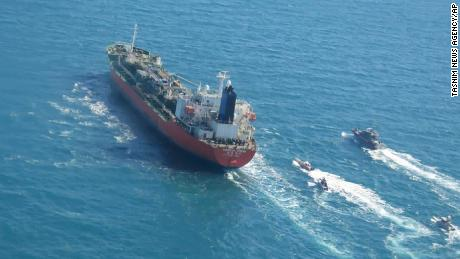 In this photo released Monday, Jan. 4, 2021, by Tasnim News Agency, a seized South Korean-flagged tanker is escorted by Iranian Revolutionary Guard boats on the Persian Gulf.
