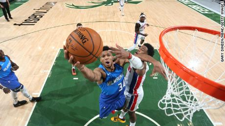 Antetokounmpo drives to the basket during the game against the Detroit Pistons.