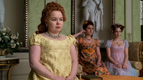 "Nicola Coughlan as Penelope Featherington, Bessie Carter as Prudence Featherington and Harriet Cains as Philipa Featherington are shown in a scene from ""Bridgerton."""