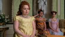 """Nicola Coughlan as Penelope Featherington, Bessie Carter as Prudence Featherington and Harriet Cains as Philipa Featherington are shown in a scene from """"Bridgerton."""""""
