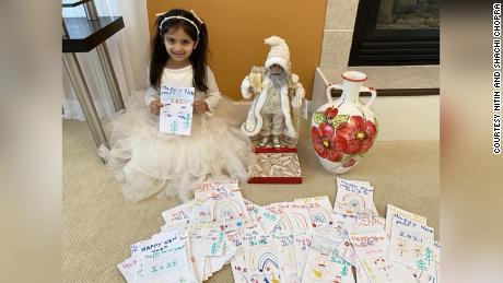 Aryana with the 200 cards and gifts she bought for residents of the Willow Point nursing home.