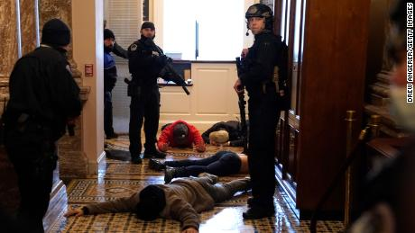 US Capitol Police detain rioters outside of the House Chamber during a joint session of Congress on January 6, 2021. (Drew Angerer/Getty Images)
