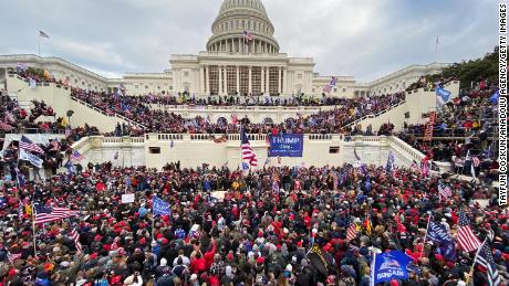 Trump supporters gather outside the Capitol Building.