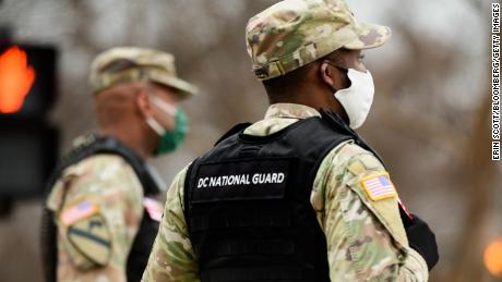 National Guard members prepared to close a road near the White House in Washington on Tuesday.