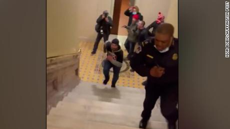 See Capitol police officer luring rioters away